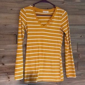 white and mustard striped top